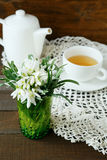 Cup of tea and spring white flower Stock Images