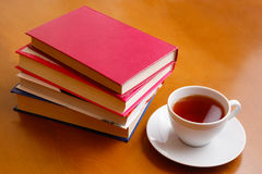 Cup of tea and stack of books Stock Image