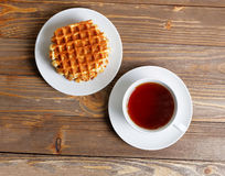 Cup of tea and stack of waffles Royalty Free Stock Photography