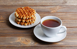 Cup of tea and stack of waffles Royalty Free Stock Photos