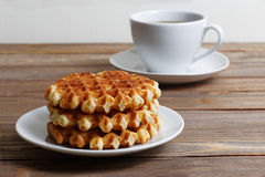 Cup of tea and stack of waffles Stock Image
