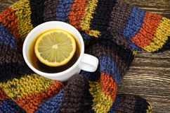 Cup of tea stand on knitted background. Stock Photography