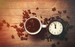 Cup of tea with star anise and alarm clock Royalty Free Stock Photography