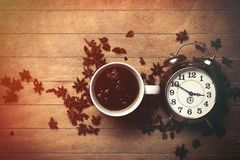 Cup of tea with star anise and alarm clock Stock Images