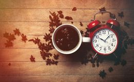 Cup of tea with star anise and alarm clock Stock Photography