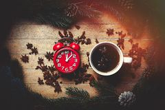 Cup of tea with star anise and alarm clock Stock Image