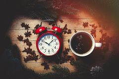 Cup of tea with star anise and alarm clock Royalty Free Stock Images