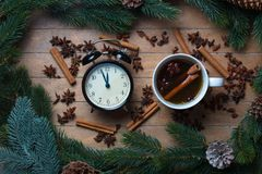 Cup of tea with star anise and cinnamon with alarm clock Stock Photo