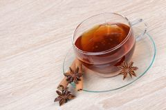 Cup of tea with star anise and cinnamon Royalty Free Stock Image