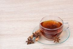 Cup of tea with star anise and cinnamon Stock Photos