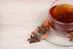 Cup of tea with star anise and cinnamon Royalty Free Stock Photos