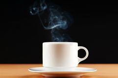 Cup of tea with steam Stock Images