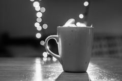 Cup of tea with steam and soft Bokeh. Royalty Free Stock Images