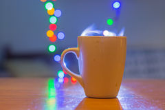Cup of tea with steam and soft Bokeh. Royalty Free Stock Photo