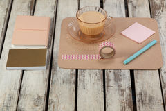 Cup of tea, sticky notes, diary, notepad, printed sellotape and pen Stock Photo