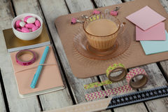 Cup of tea, sticky notes, paper pins, clips, printed sellotape, ruler and pen Stock Photo