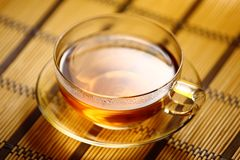 Cup of tea on straw tablecloth Stock Photography