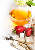 Cup of tea and strawberries over white Royalty Free Stock Photos