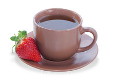 Cup of tea with strawberries on saucer Stock Photography