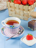 A cup of tea with a strawberry-yogurt dessert. A cup of redbush tea with a strawberry-yogurt dessert Stock Image