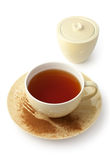 Cup of tea and sugar bowl. Cup of tea with saucer and sugar bowl on white background (Clipping path included Stock Photo