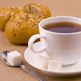 Cup of tea, sugar and bread Stock Photos