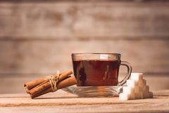 A cup with tea, sugar and cinnamon stock images