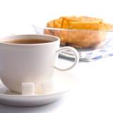Cup of tea, sugar and cookies Stock Photos