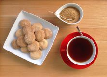 Cup of tea, sugar and cookies Stock Photos