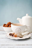 Cup of tea. And sugar with cookies  over blue background Royalty Free Stock Photo