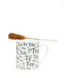 Cup of tea and sugar crystals Stock Images