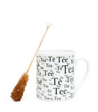 Cup of tea and sugar crystals Stock Image
