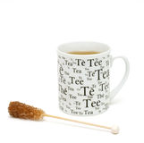 Cup of tea and sugar crystals Stock Photo