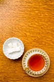 Cup of tea and sugar cubes. Overhead view of a cup of tea and sugar cubes Royalty Free Stock Photo
