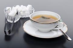 A cup of tea with sugar Stock Photos
