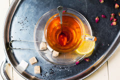 Cup of tea with sugar and lemon Stock Photography