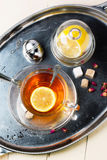 Cup of tea with sugar and lemon Royalty Free Stock Images