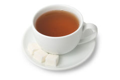 Cup of tea and sugar on saucer Stock Photos
