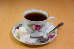 A cup of tea and sugar on a saucer Royalty Free Stock Photography