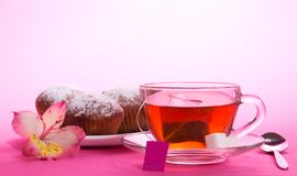Cup of tea and sugar on saucer, teaspoon. Cup of tea and sugar on a saucer, a teaspoon, on a pink background royalty free stock photos