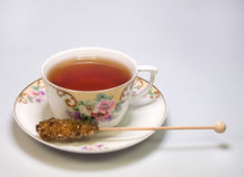 Cup of tea with sugar stick Royalty Free Stock Image