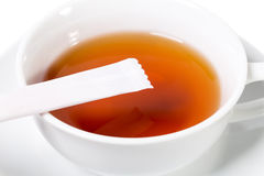 Cup of tea and sugar stick closeup. Royalty Free Stock Photo