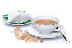 A cup of tea with sugar and tea bags Royalty Free Stock Photo
