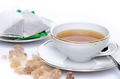 A cup of tea with sugar and tea bags Royalty Free Stock Image