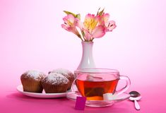 Cup of tea, sugar, teaspoon and alstroemeria Stock Photo