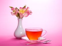 Cup of tea and sugar, teaspoon, vase Royalty Free Stock Photo