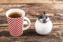 Cup of tea with sugar stock images