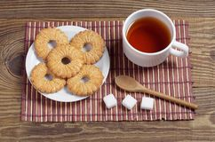 Cup of tea and sweet cookies stock photo