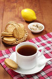 Cup of tea and sweet cookies Stock Image