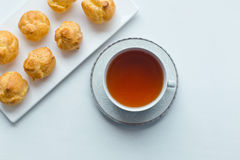 Cup of tea and sweet pastries Stock Photography